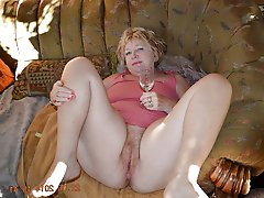 Charming mature MILF getting naked on cam