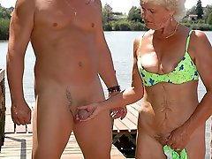 Charming old milf giving head