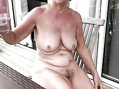 Older bitch posing totally nude on camera